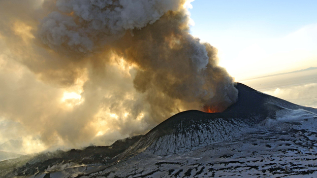"""Plosky Tolbachnik volcano erupts in Russia's Far Eastern Kamchatka Peninsula on Jan. 6, 2013. It's not a so-called """"super volcano,"""" but every million years or so scientists say the Earth burps up volcanoes that can erupt for thousands of years. (AP)"""