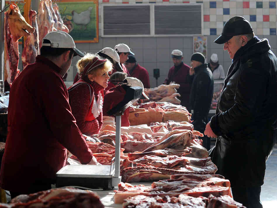 A man buys meat at a butcher's stand in Moscow's Dorogomilovsky market in 2011. On Monday, Russia began blocking U.S. meat imports until those imports are ractop