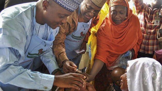 A Nigerian health commissioner Dr. Sani Malam vaccinates a child for polio during a national immunization drive in Bauchi, Nigeria, last week. (EPA /Landov)