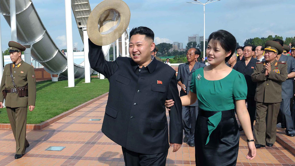 North Korean leader Kim Jong Un, accompanied by his wife, Ri Sol Ju, in a photo released last summer. For North Koreans, it was stunning to see the first lady at the leader's side. But North Korea still produces heavy-handed propaganda as well. (AP)