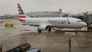 An American Airlines 737-800 aircraft featuring the company's new logo sits at a gate at Chicago's O'Hare International Airport in January. American's merger with US Airways would create the largest U.S. airline.