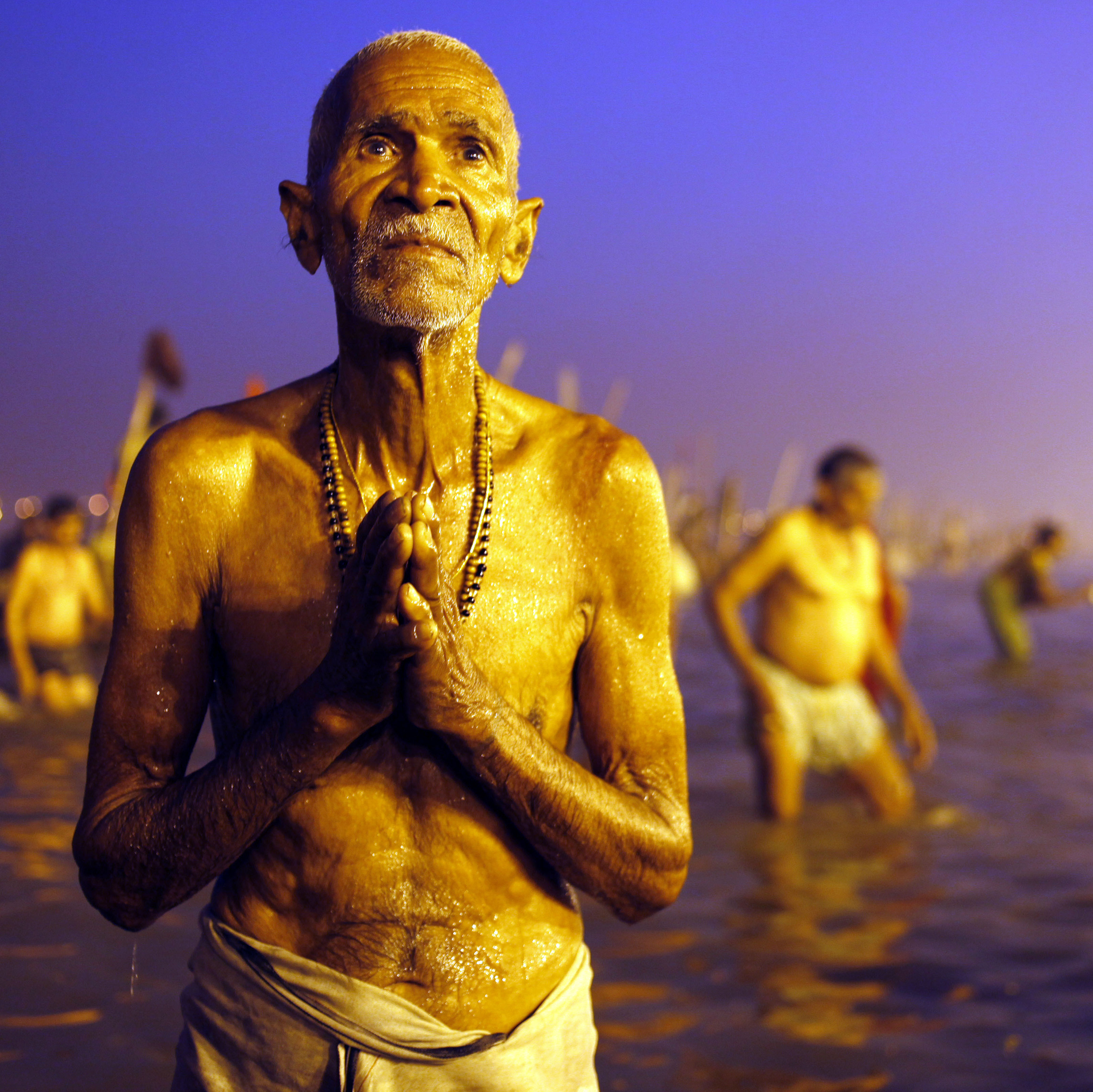 A Hindu devotee prays after a holy dip at the Sangam, the confluence of three holy rivers -- the Ganges, the Yamuna and the mythical Saraswati --� during the Kumbh Mela festival in Allahabad, India, on Sunday.