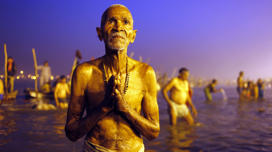 "A Hindu devotee prays after a holy dip at the Sangam, the confluence of three holy rivers — the Ganges, the Yamuna and the mythical Saraswati --"" during the Kumbh Mela festival in Allahabad, India, on Sunday. (AP)"