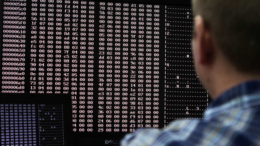 An analyst looks at code in the malware lab of a cybersecurity defense lab at the Idaho National Laboratory in Idaho Falls, Idaho, Sept. 29, 2011.