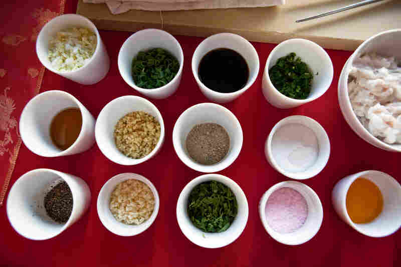 "A dozen flavors go into Drewno's dumplings. Most important, the seasonings include the ""holy trinity"" of scallions, ginger and garlic, a couple of kinds of salt, oyster sauce and more. They are added into the pork and pork fat, and mixed to a fine paste."
