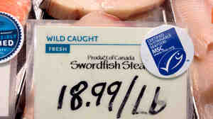 Swordfish from Canada are marked with a label from the Marine Stewardship Council at a Whole Foods in Washington, D.C. The MSC says its label means the fish were caught by a sustainable fishery, but critics says it's not always so clear.