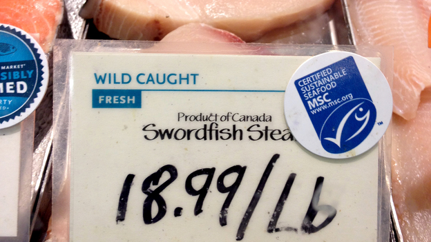 Swordfish from Canada are marked with a label from the Marine Stewardship Council at a Whole Foods in Washington, D.C. The MSC says its label means the fish were caught by a sustainable fishery, but critics says it's not always so clear. (NPR)