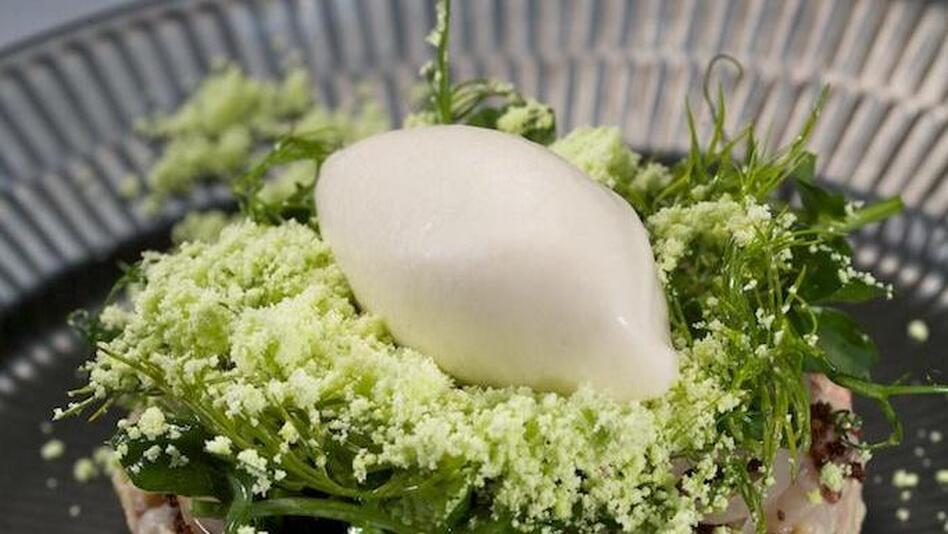 Reykjavik-based Dill Restaurant offers up new Nordic cuisine: herring ice cream on salad and rye. (Courtesy of Gunnar Karl Gislason)