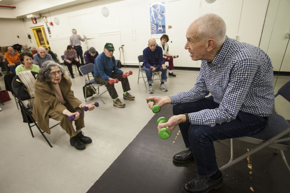 John David, 73, teaches fitness classes to help older people stay healthy and fit. Here he teaches an hourlong class at the 92nd Street Y in New York City. (Shiho Fukada for NPR)