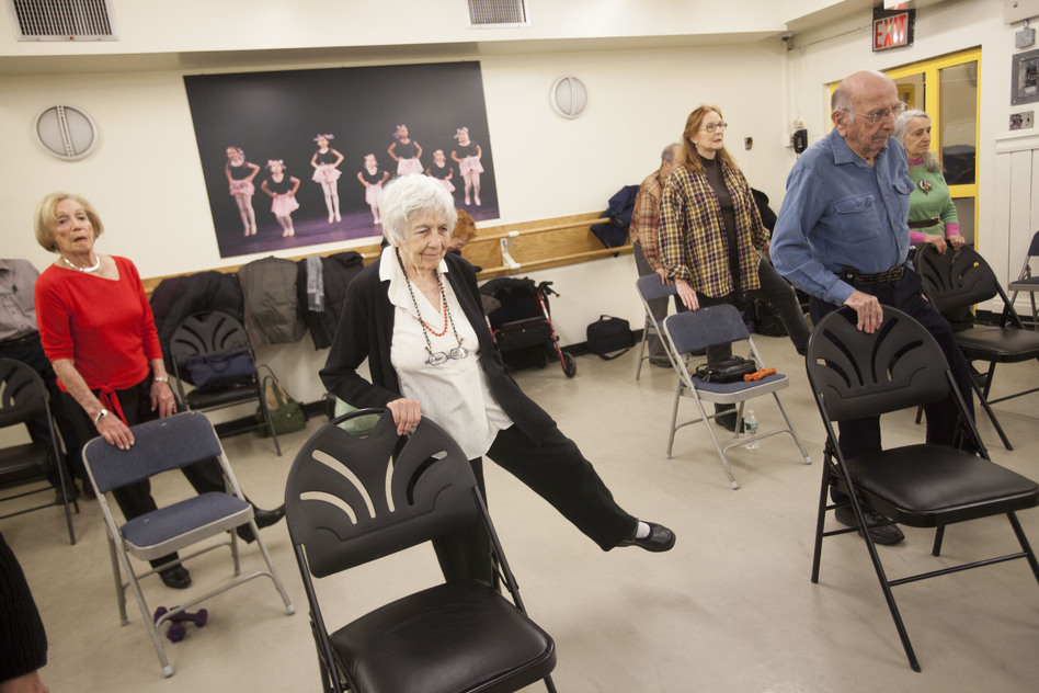 Seniors work out at John David's fitness class at the 92nd Street Y. (Shiho Fukada for NPR)