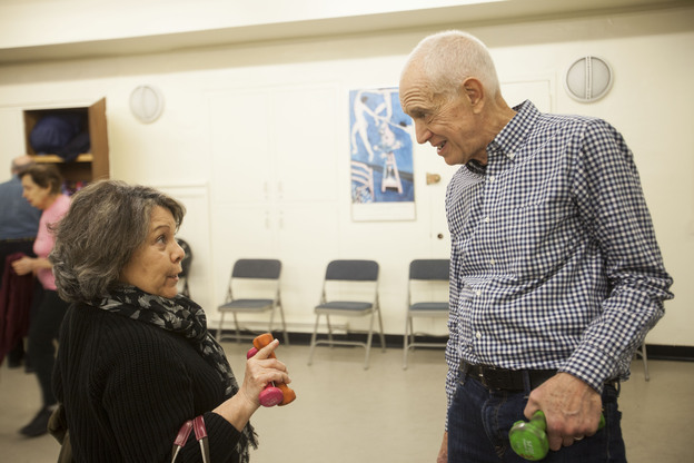 John David, 73, chats with one of his students after his exercise class at the 92nd St Y in New York. (Shiho Fukada for NPR)