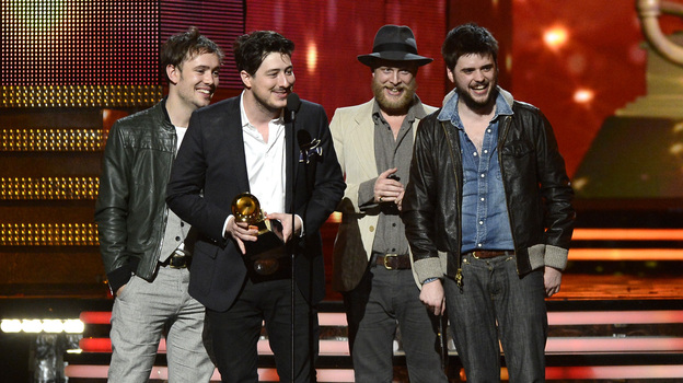 Mumford & Sons (from left: Ben Lovett, Marcus Mumford, Ted Dwane and Winston Marshall) accept the award for album of the year at the Grammy Awards on Sunday night. (Getty Images)