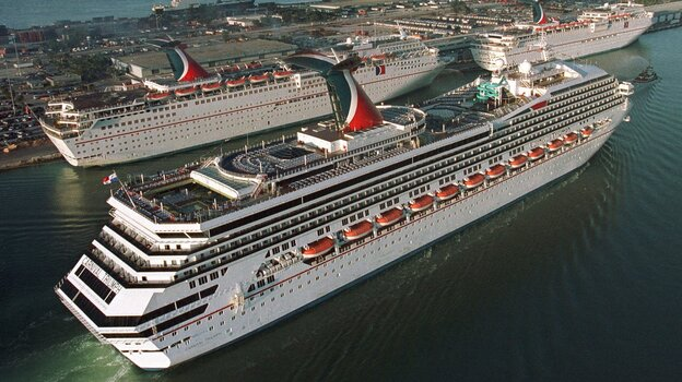 In a photo from 1999, the Carnival Cruise line Carnival Triumph, foreground, arrives in Miami. Measuring 893 feet in length, the ship has been adrift in the Gulf of Mexico for more than 24 hours, after a fire hit its engines. (AP)