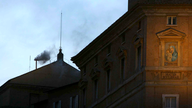 Black smoke rises from the chimney of the Sistine Chapel on April 18, 2005. Black smoke signaled that the cardinals sequestered inside had failed to elect a new pope, after the death of Pope John Paul II. (AP)