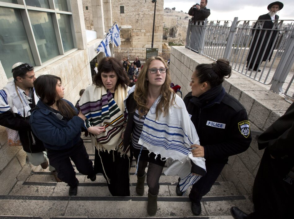 Rabbi Susan Silverman (center, left), the sister of American comedian Sarah Silverman, along with her teenage daughter Hallel Abramowitz (center, right), are arrested by Israeli police as they leave the Western Wall in Jerusalem, on Monday.