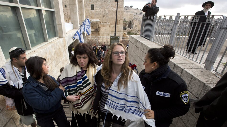 Rabbi Susan Silverman (center, left), the sister of American comedian Sarah Silverman, along with her teenage daughter Hallel Abramowitz (center, right), are arrested by Israeli police as they leave the Western Wall in Jerusalem, on Monday. (EPA/Landov)