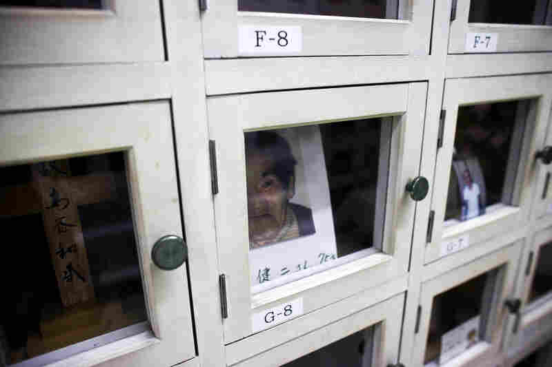 "The remains of workers with no relatives sit in a locker room of an NGO in Osaka, Japan. Many men here don't have family ties, and live and die alone as social outcasts from the mainstream ""salaryman"" culture."