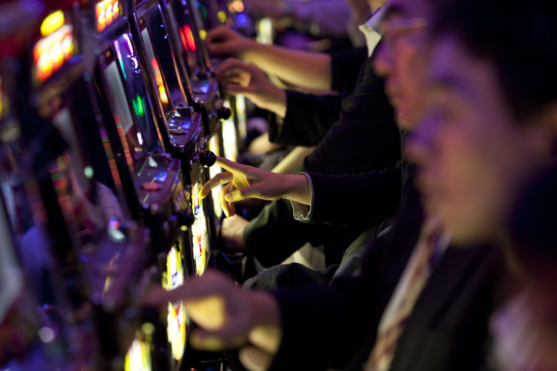 "Japanese businessmen play pachinko after work in Tokyo. Japanese white-collar workers, also known as ""salarymen,"" increasingly work longer hours because of the fear of losing jobs and a shortage of manpower. Excessive overwork causes depression, and in some cases leads to suicides."