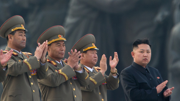 North Korean leader Kim Jong Un (right) claps during a ceremony unveiling statues honoring his grandfather and father, Kim Il Sung and Kim Jong Il, respectively, in Pyongyang last April. (AFP/Getty Images)
