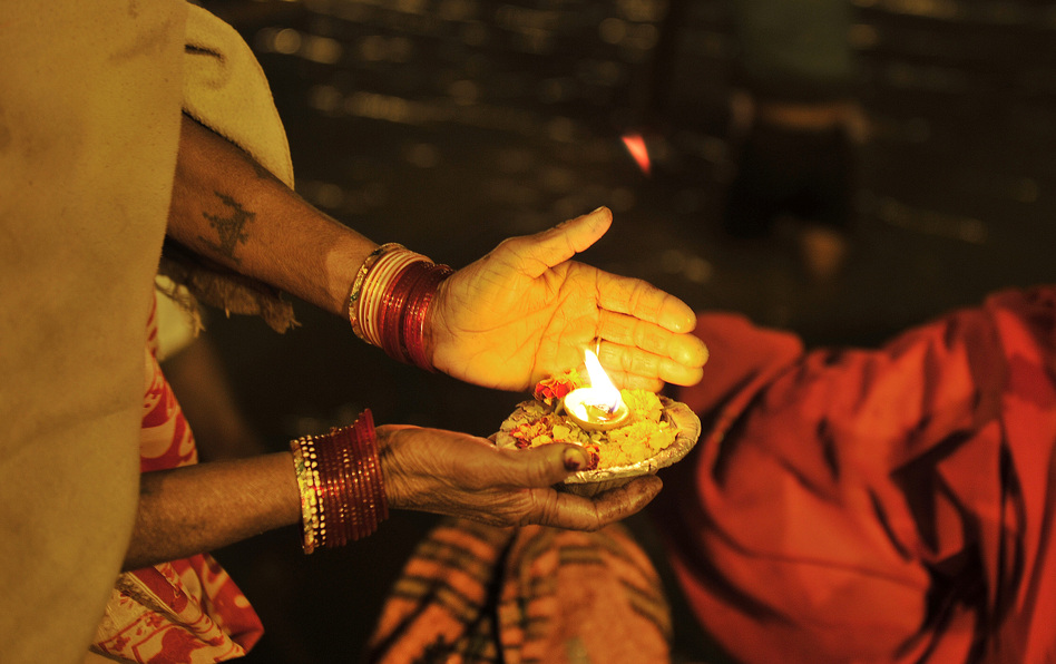 An Indian devotee holds an offering at the Sangam. (AFP/Getty Images)