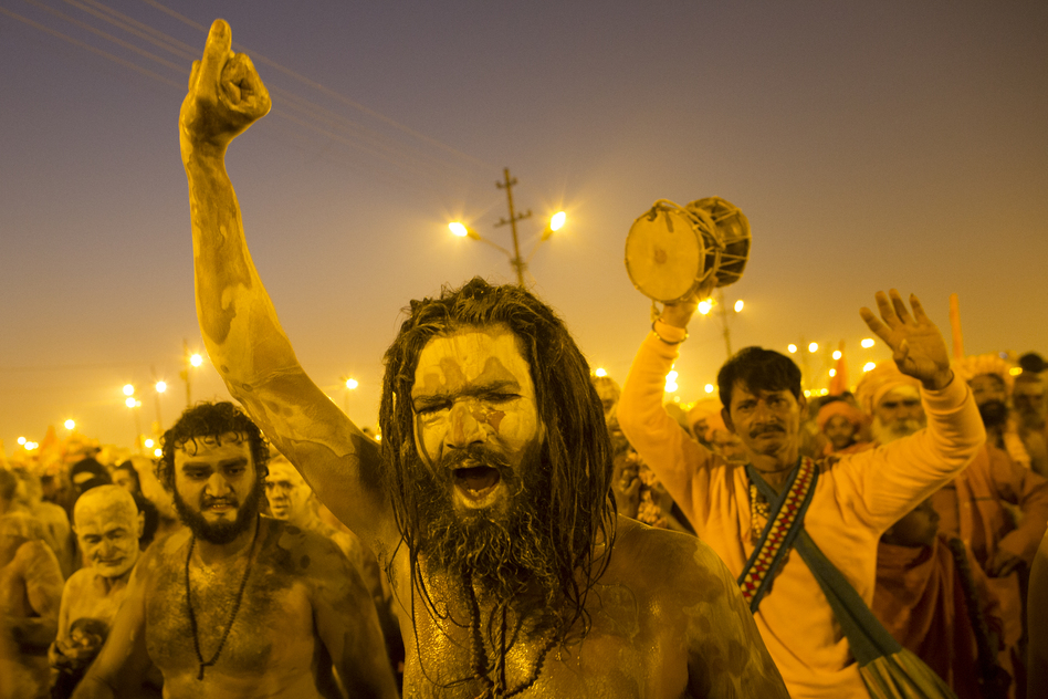 Naga sadhus, naked holy men, walk in procession after bathing on the auspicious day of Mauni Amavasya on Sunday. (Getty Images)