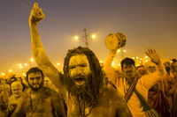 <em>Naga sadhus</em>, naked holy men, walk in procession after bathing on the auspicious day of Mauni Amavasya on Sunday.