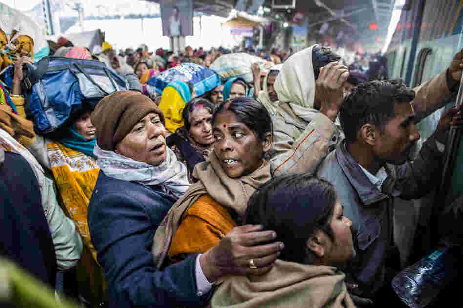 Hindu devotees cram as they board their train Monday at Allahabad train station, the site of Sunday's stampede. Thirty-seven people were killed in the stampede.