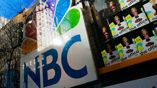 An NBC store is seen through a window reflecting Rockefeller Center in New York City. Comcast, the nation's largest cable company, has owned 51 percent of NBCUniversal since 2011. (Getty Images)