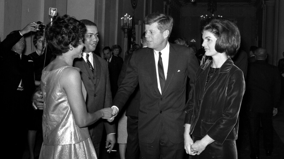 President and Mrs. Kennedy greet Clarence C. Feurgeson Jr., counsel to the Civil Rights Commission, and his wife, at the White House reception. (Courtesy of JFK Presidential Library)