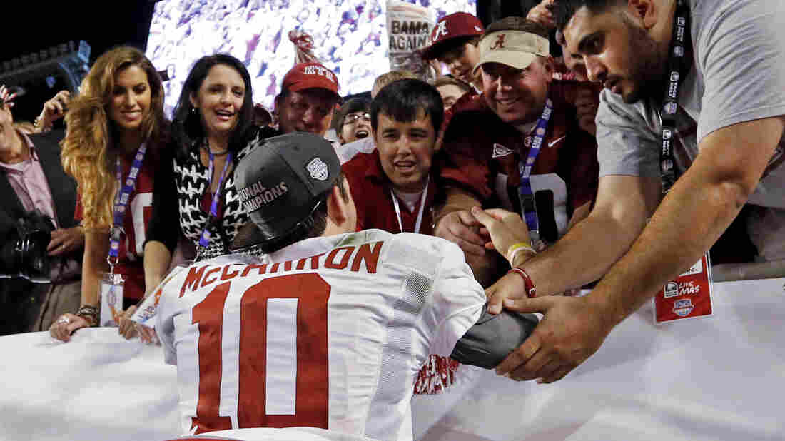"Katherine Webb (left), the girlfriend of Alabama quarterback A.J. McCarron, and McCarron's mother, Dee Dee Bonner (second from left), watch McCarron celebrate after the BCS National Championship college football game on Jan. 7. Webb was caught on camera and announcer Brent Musburger enthusiastically remarked that quarterbacks ""get all the good-looking women."" ESPN later apologized."