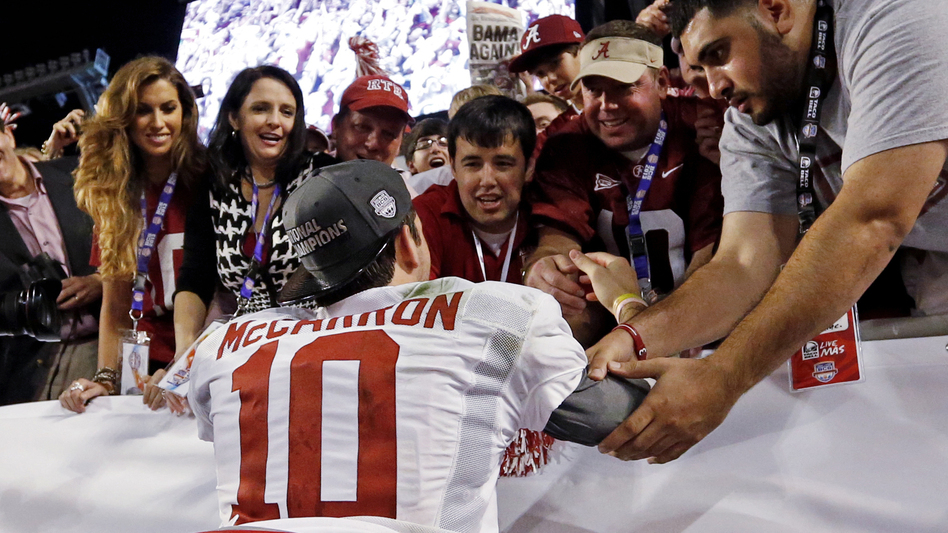 "Katherine Webb (left), the girlfriend of Alabama quarterback A.J. McCarron, and McCarron's mother, Dee Dee Bonner (second from left), watch McCarron celebrate after the BCS National Championship college football game on Jan. 7. Webb was caught on camera and announcer Brent Musburger enthusiastically remarked that quarterbacks ""get all the good-looking women."" ESPN later apologized. (AP)"