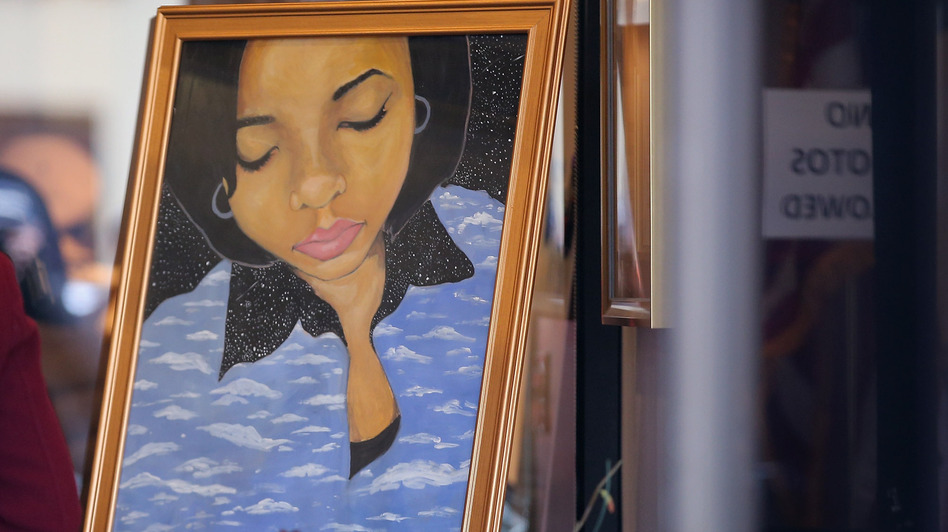 At a Chicago funeral home last week, a painting of 15-year-old shooting victim Hadiya Pendleton stood at the entrance. (Getty Images)