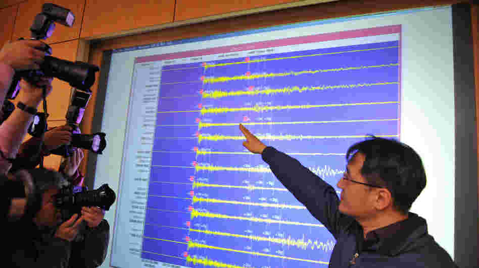 An official with the Korea Meteorological Administration shows a seismic image of a tremor caused by North Korea's nuclear test, in Seoul on Tuesday.