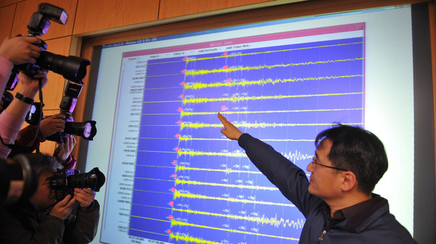 An official with the Korea Meteorological Administration shows a seismic image of a tremor caused by North Korea's nuclear test, in Seoul on Tuesday. (AFP/Getty Images)