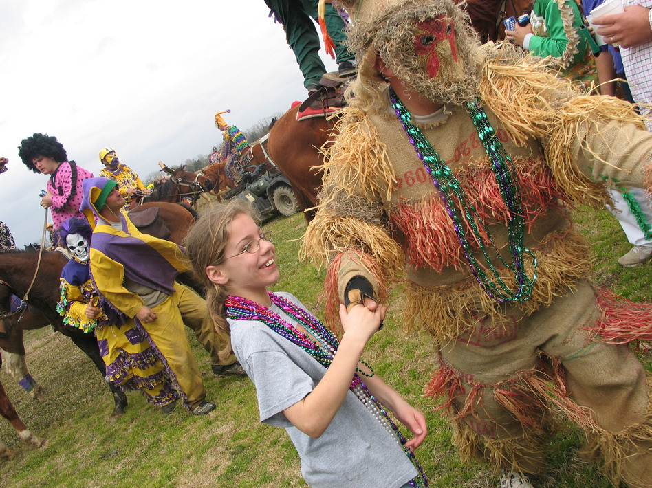 A reveler dances with a young girl during the Courir de Mardi Gras in Mamou, La., in 2007.