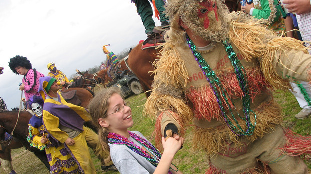 A reveler dances with a young girl during the Courir de Mardi Gras in Mamou, La., in 2007. (MCT /Landov)