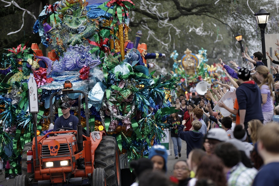 Monday: Floats pass down Napoleon Ave. during the Krewe of Mid-City parade. (AP)