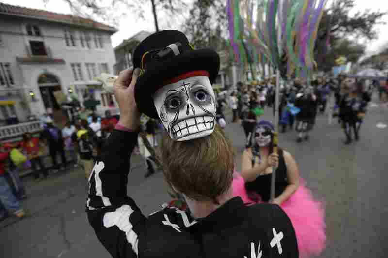Sunday: A masked reveler in the Krewe of Okeanos parade.