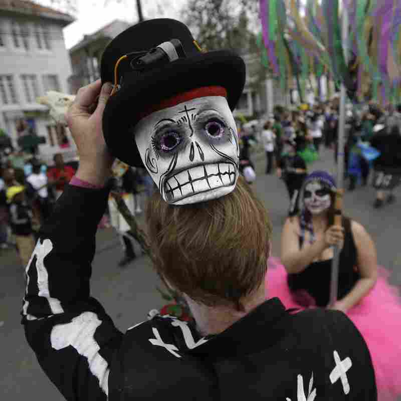 'The Street Parade Of Life:' Mardi Gras Rolls On Despite Rain Threat