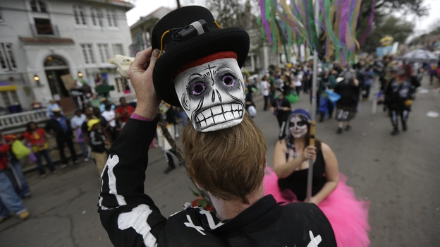 A reveler shows off his mask during the Krewe of Okeanos parade in New Orleans on Feb. 10, 2013. (AP)