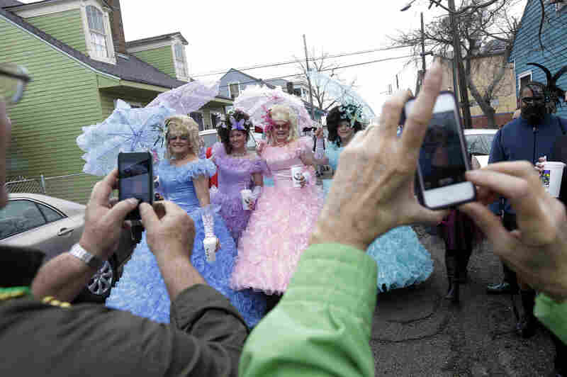 Tuesday: Revelers gather before the start of the Society of Saint Anne parade.