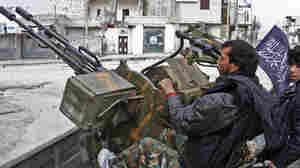 Syrian Rebels Take Air Base, Dam In Northern Syria
