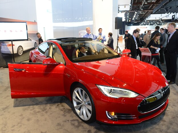 Showgoers check out the Tesla Model S at the 2013 North American International Auto Show in Detroit in January.