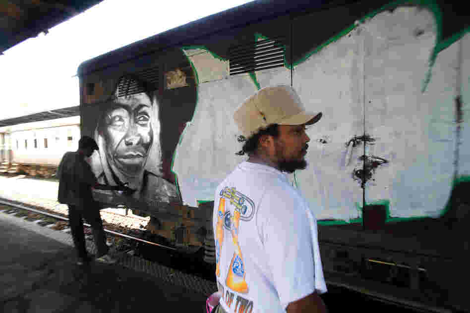"27-year-old Uhuru B has been a graffiti artist for 12 years. ""What we're doing here now is part of a civic education, and also a way to advertise peace,"" he says."