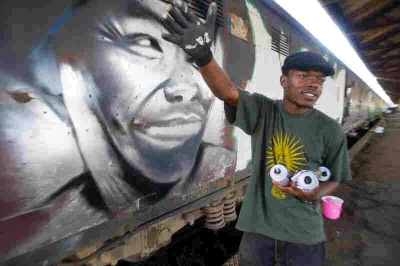 Kenyan graffiti artists received permission from the Rift Valley Railway to spray-paint a 10-car commuter train with messages of peace. Here, true to his name, Swift9 finishes his piece before anyone else: a portrait of Nobel Peace Prize winner Wangari Maathai.
