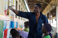 Stephen Onyango Owino paints the train with the help of kids from