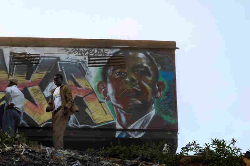 """U.S. President Barack Obama as rendered by the artist Bankslave, who was born and still lives in the Kibera slum. During the previous election violence, looters spared his house when they recognized him as """"the guy who paints murals"""" around Kibera."""