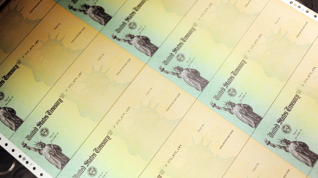 U.S. Treasury checks are run through a printer.