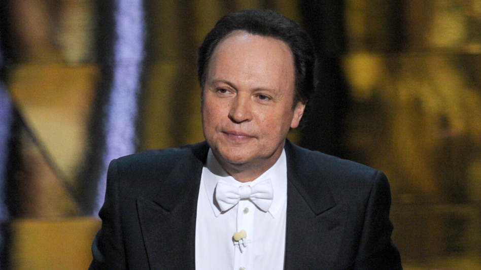 Billy Crystal hosts the 84th Annual Academy Awards in 2012. Writing jokes for hosts is a tricky game, says longtime joke writer Dave Boone. (Getty Images)