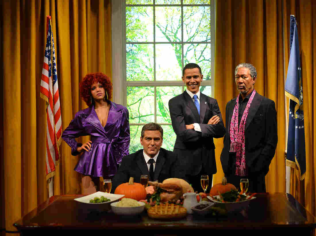 Wax Rihanna, Wax George Clooney, Wax Barack Obama, and Wax Morgan Freeman enjoy Thanksgiving dinner together in November 2012.